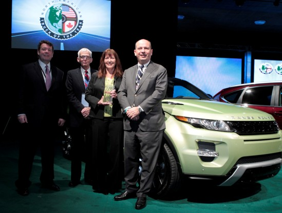 (L to R) Andy Goss, President, Jaguar Land Rover North America; Tony Swan, Editor-at-Large, Car and Driver; Kim McCullough, Brand Vice President, Land Rover North America and Frank Klaas, Global Head of Communications, Jaguar Land Rover, with the 'North American Truck of the Year' award for the 2012 Range Rover Evoque at the North American International Auto Show in Detroit on January 9, 2012. This marks the first North American Truck of the Year win for Land Rover.